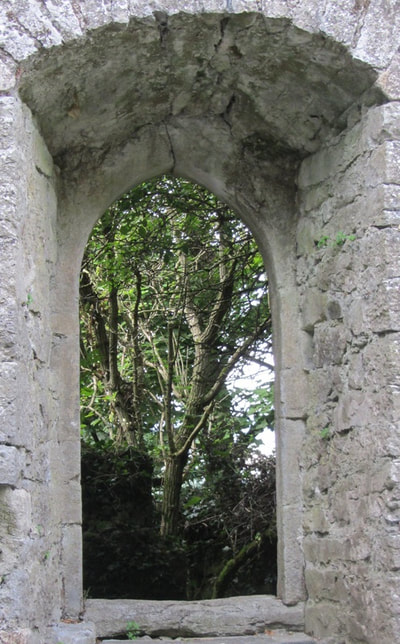 Through the arched window in the tower at 3 Castles.